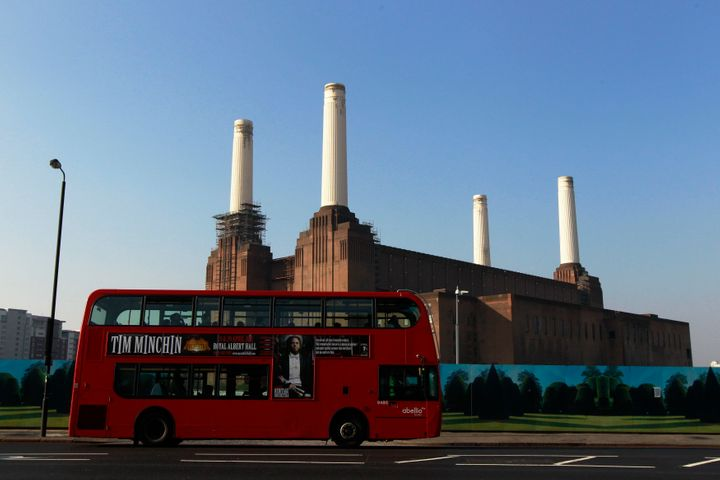 A bus passes the Battersea Power Station, a decommissioned coal plant, in London in 2011.