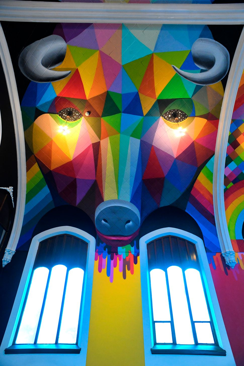 The interior painting was done by Spanish artist Okuda San Miguel. American artist Kenny Scharf painted the church facade.