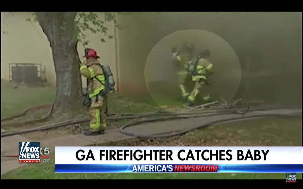 Hero Firefighter Catches Baby Dropped From Window Of Burning