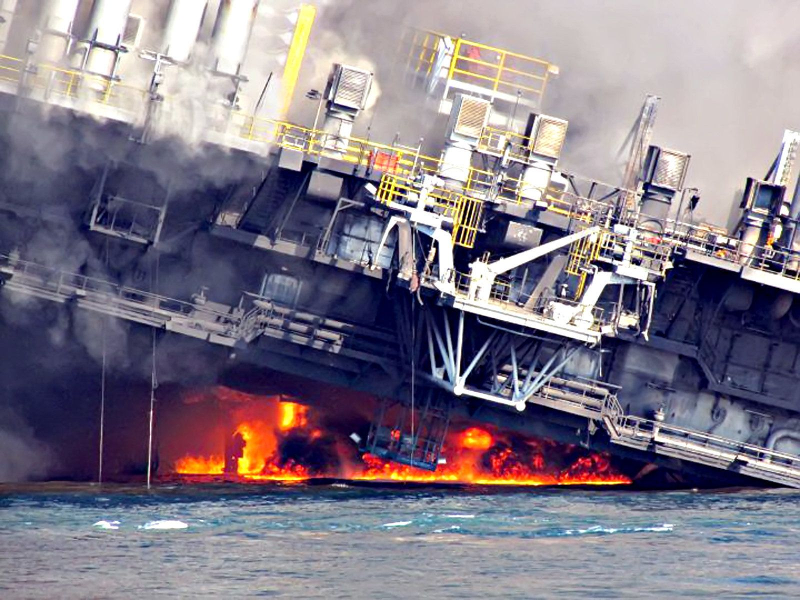 The offshore oil rig Deepwater Horizon burns in the Gulf of Mexico April 21, 2010. A huge oil slick remained offshore and largely stationary today, May 4, 2010, in a development that should help cleanup efforts. (Photo courtesy Jon T. Fritz/MCT via Getty Images)