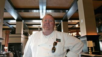 "- PHOTO TAKEN 11APR06 - Celebrity chef Mario Batali poses in his latest restaurant, Del Posto, in New York April 11, 2006. Known to [fans] as ""Super Mario,"" his most recent venture, Del Posto, has attracted as much attention for the price of valet parking - $29, as for the quality of the food. Photo taken April 11, 2006."