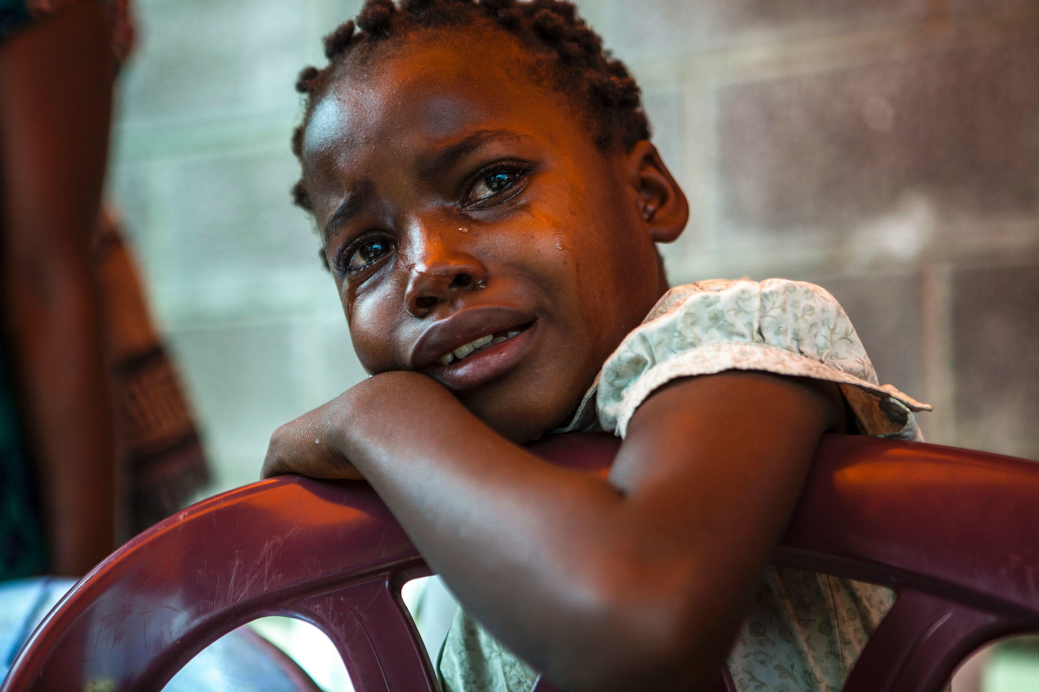 A girl cries outside the Bondeko morgue in Kinshasa, Congo, on Oct. 31,