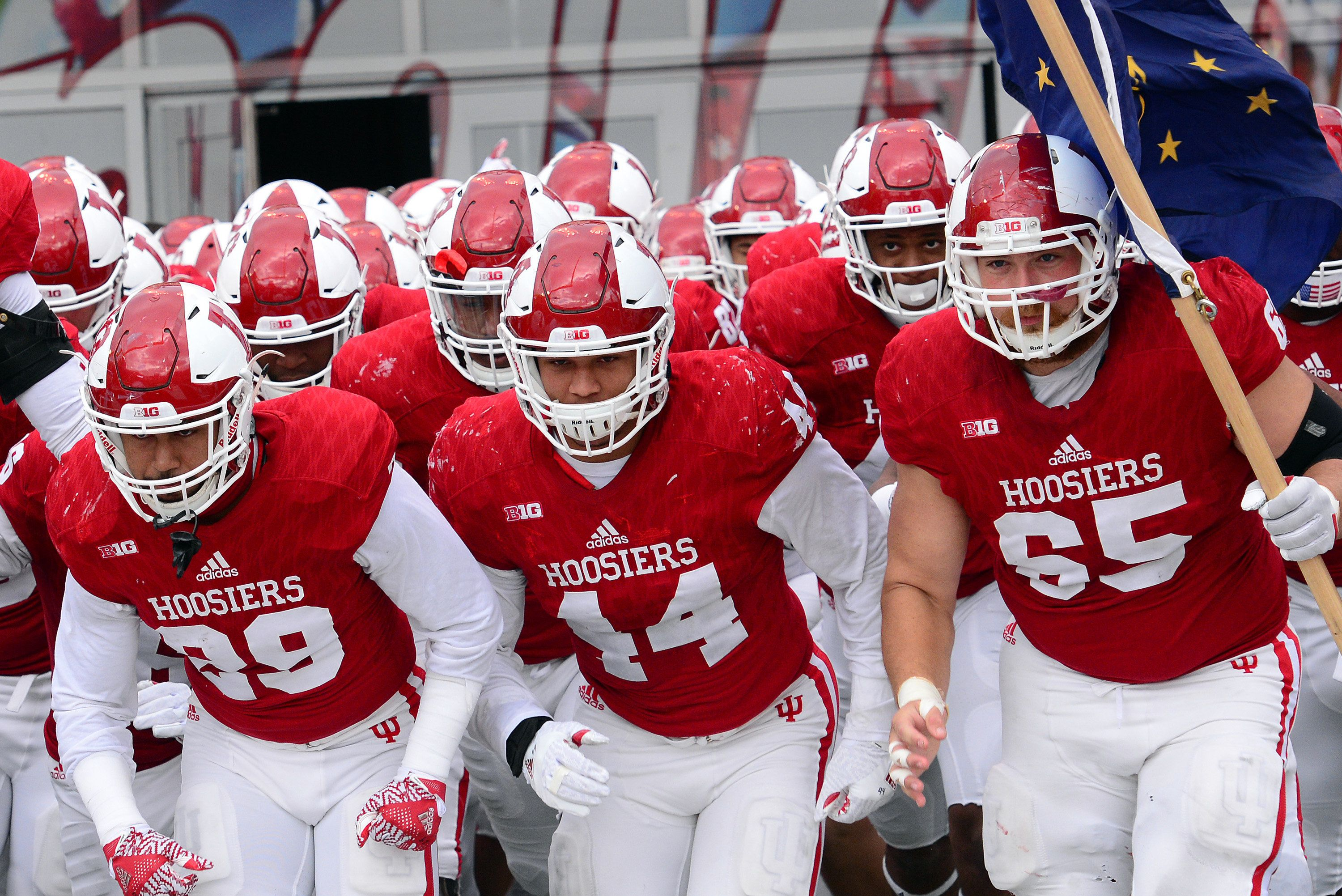 BLOOMINGTON, IN - NOVEMBER 26: Indiana University Hoosiers Offensive Lineman Wes Rogers (65) carries an Indiana State flag as the team runs onto the field for the Big Ten Conference game between the Purdue Boilermakers and the Indiana Hoosiers on November 26, 2016, at Memorial Stadium in Bloomington, Indiana. (Photo by Michael Allio/Icon Sportswire via Getty Images)