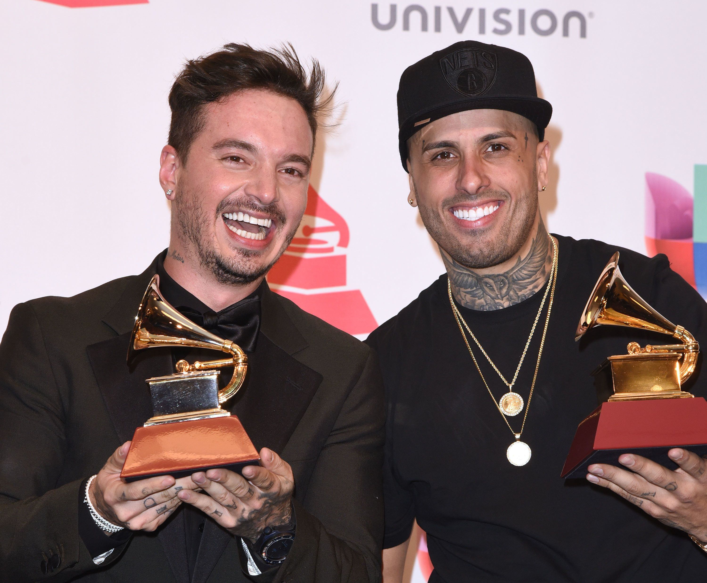 Started from the bottom, now they're... Latin Grammy friends.