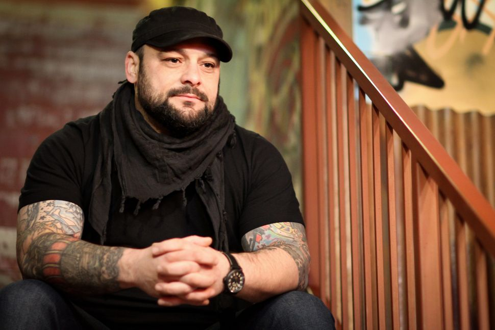 "Christian Picciolini says what attracted him to a skinhead group ended up being ""false power and false respect."""