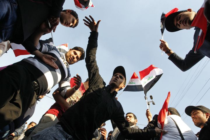 Supporters of Iraqi cleric Moqtada al-Sadr demonstrate in Baghdad on Feb. 8 to demand reforms from Iraq's leading partie