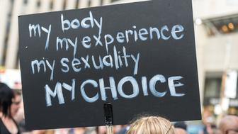'Toronto, Canada - May 25, 2012: A protest sign during ''Slut Walk 2012'', a protest event about sexual assault and victims' rights, among other related issues.'
