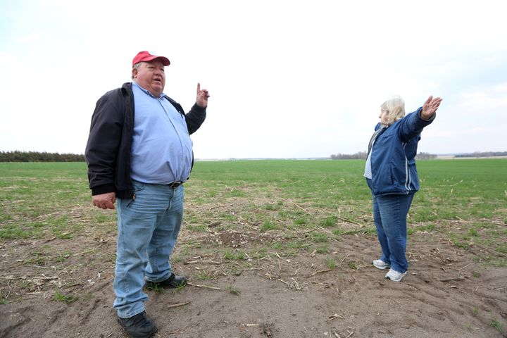 Art and Helen Tanderup show where the Keystone XL pipeline would cut through the farm near Neligh, Nebraska, that's been in H