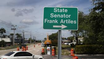 MIAMI, FL - APRIL 21:  A sign points the way to the office of State Senator Frank Artiles who resigned today from the Florida Senate on April 21, 2017 in Miami, Florida.  Mr. Artiles resigned after he insulted two lawmakers at a Tallahassee bar with racists and sexist remarks. (Photo by Joe Raedle/Getty Images)