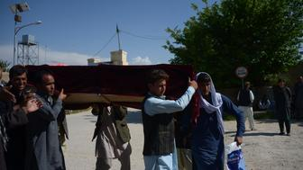 Afghan relatives carry the coffin of a Afghan National army (ANA) soldier killed in a Taliban attack on an army base in the Dihdadi district of Balkh province on April 22, 2017. More than 100 Afghan soldiers have been killed and wounded in a coordinated Taliban attack on an army base in northern Afghanistan, the country's defence ministry said. 'The majority of our soldiers were offering Friday prayers' at the time of the assault, the ministry said in a statement, adding that 'over 100 Afghan army forces were martyred and wounded'. / AFP PHOTO / FARSHAD USYAN        (Photo credit should read FARSHAD USYAN/AFP/Getty Images)