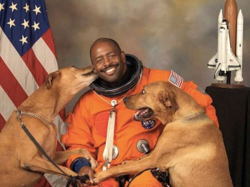 Leland Melvin's official 2009 NASA portrait featured his dogs, Scout and Jake.