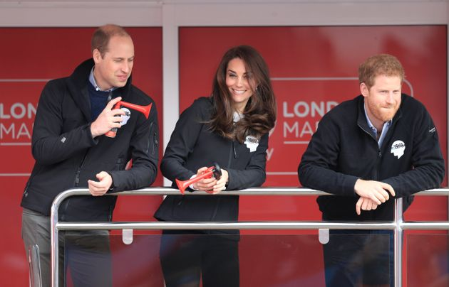The Duke and Duchess of Cambridge signal the start of the marathon, as Prince Harry watches