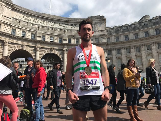 Matthew Rees, 29, from Swansea, who helped carry an exhausted runner over the marathon finishing