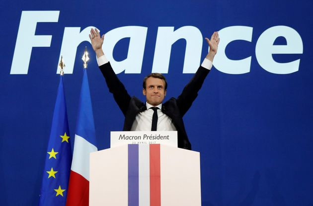 Emmanuel Macron celebrates after partial results in the first round of 2017 French presidential election,...