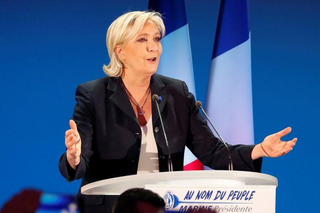 Marine Le Pen delivers a speech after early results in the first round of 2017 French presidential election,...