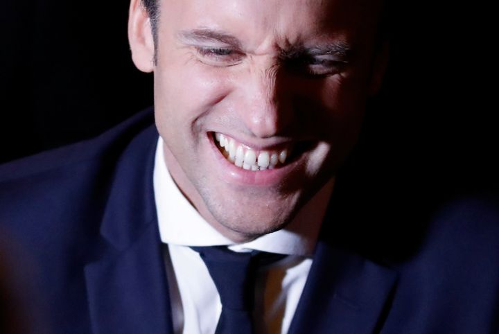Emmanuel Macron smiles at his campaign headquarters.