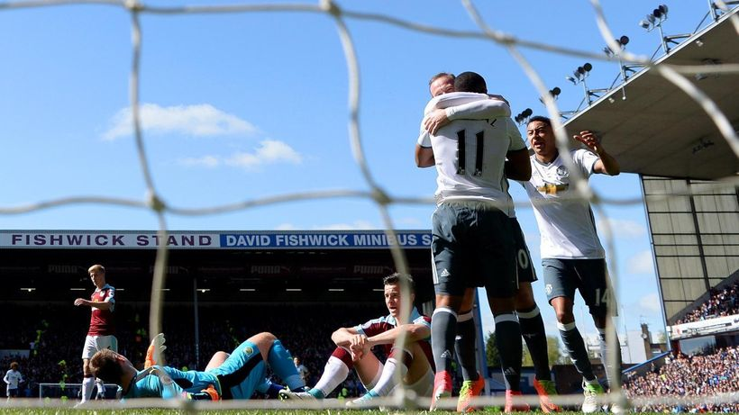 Goalscorers Wayne Rooney and Anthony Martial celebrate after making it 0:2 to United at Turf Moor on Sunday 23 April.