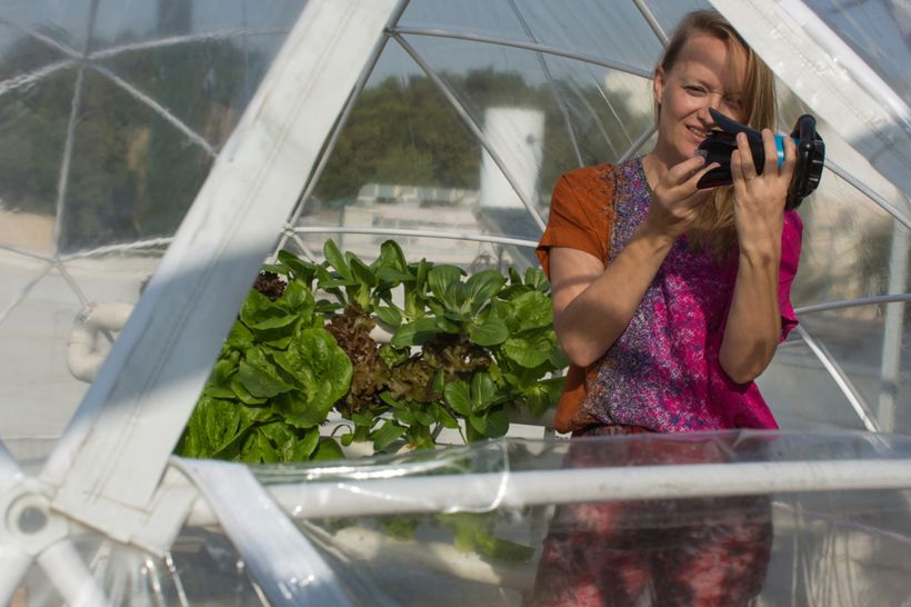 Karin Kloosterman holding Eddy in her Middle Eastern year-round garden. Image via Bloomberg.