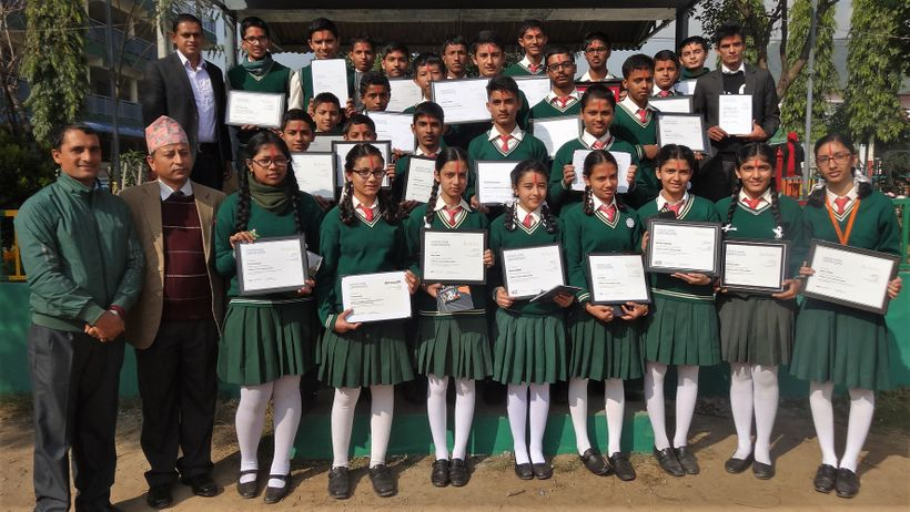<em>Nepalese teacher Baman Kumar Ghimire (far left) stands with students who completed their first online course.</em>