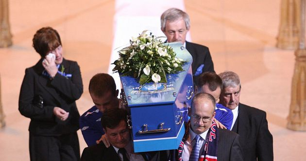 Rhys's coffin is carried out of Liverpool's Anglican Cathedral following his