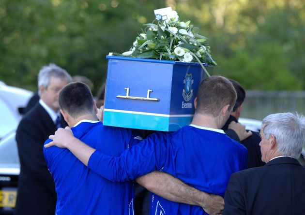 His pallbearers included his father (left) and brother Owen (right), both of whom wore Everton