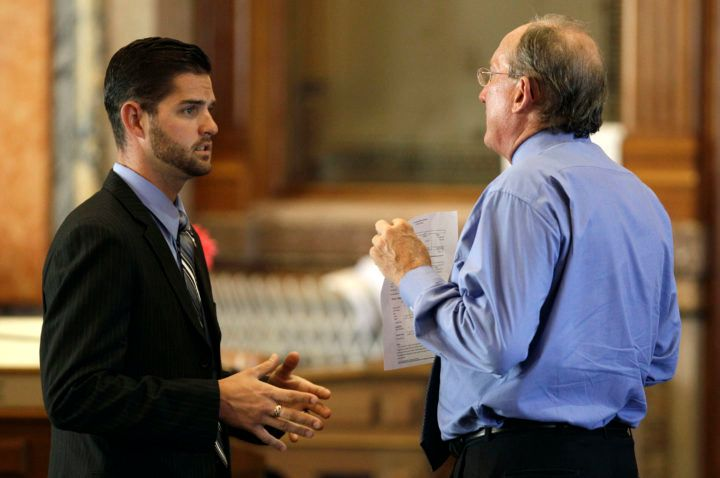 "Representative Matt Windschitl (left), the sponsor of Iowa's ""stand your ground"" law, speaks with a colleague at the state ca"