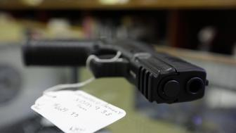 A hand gun, very similar to the gun allegedly used by alleged gunman Wade Michael Page is seen at The Shooters Shop in West Allis, Wisconsin, on August 7, 2012, the same store where Page purchased the weapon. The gun used in the crime was the crime was identical, only it had a shorter barrel. Page allegedly killed six people and critically wounded three at a Sikh temple on Sunday in an attack authorities are treating as an act of domestic terrorism. (Photo by John Gress/Corbis via Getty Images)