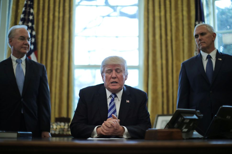 Trump talks to journalists at the Oval Office of the White House after the American Health Care Act was pulled before a