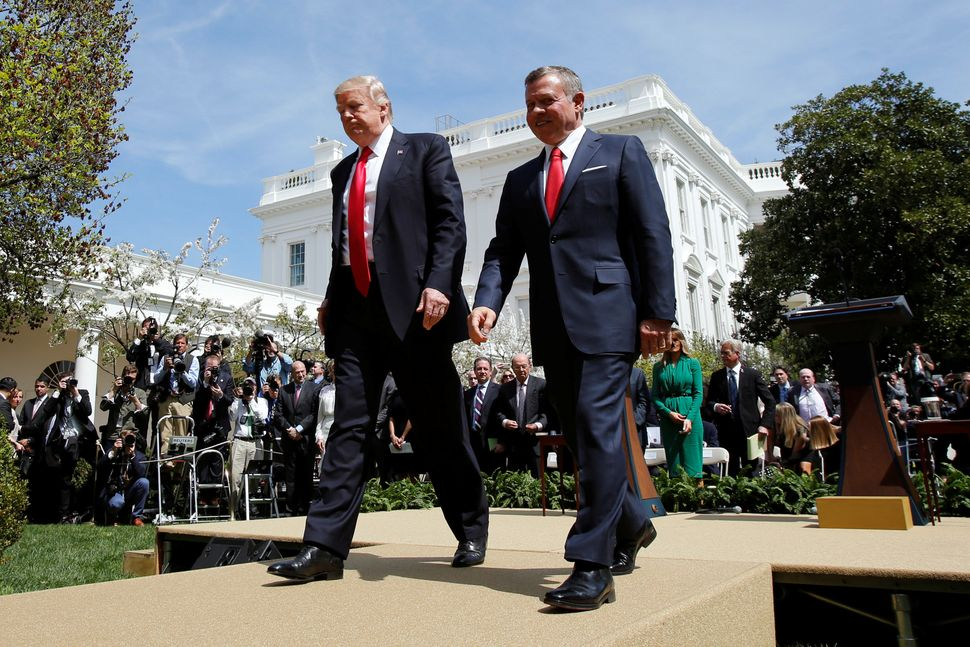 Trump, left, and Jordan's King Abdullah II leave after a joint news conference in the Rose Garden at the White House on April