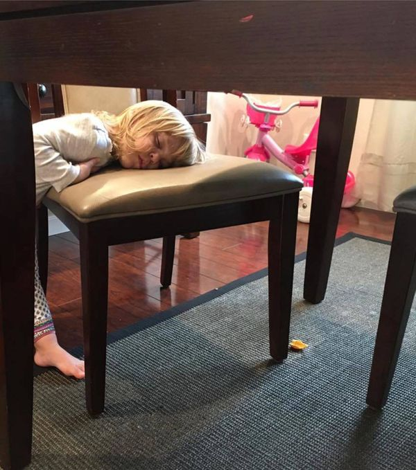 This is a chair in our dining room -- her mid-day nap was not long enough I guess, so she fell asleep again after waking up :