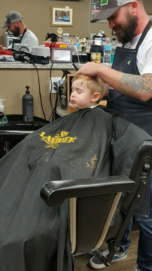 He fell asleep getting his hair cut and had everybody in the shop laughing!