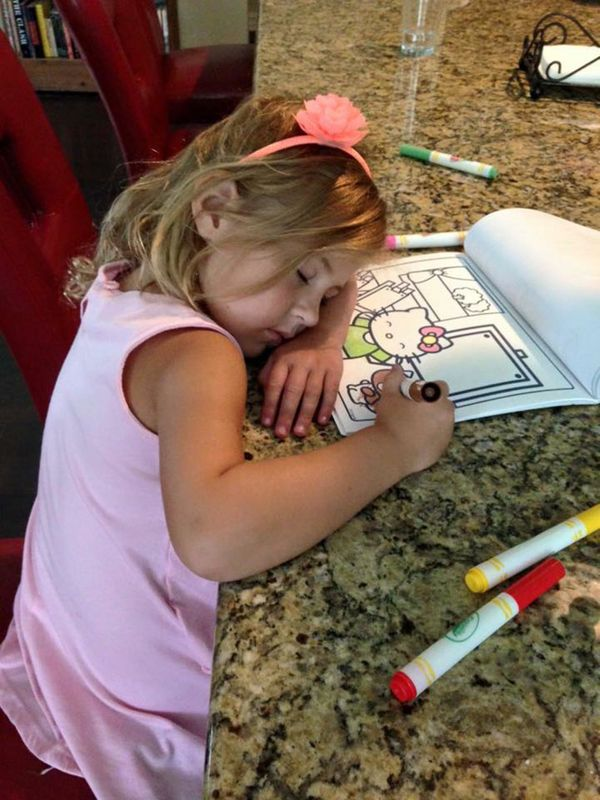 She falls asleep everywhere. Coloring in her dreams....