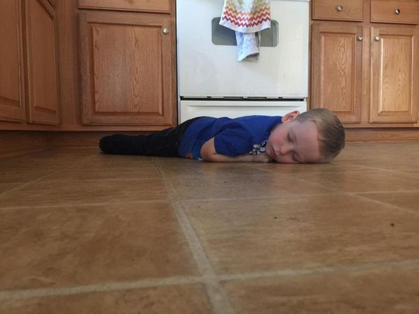 On the kitchen floor, after his 3rd birthday party.
