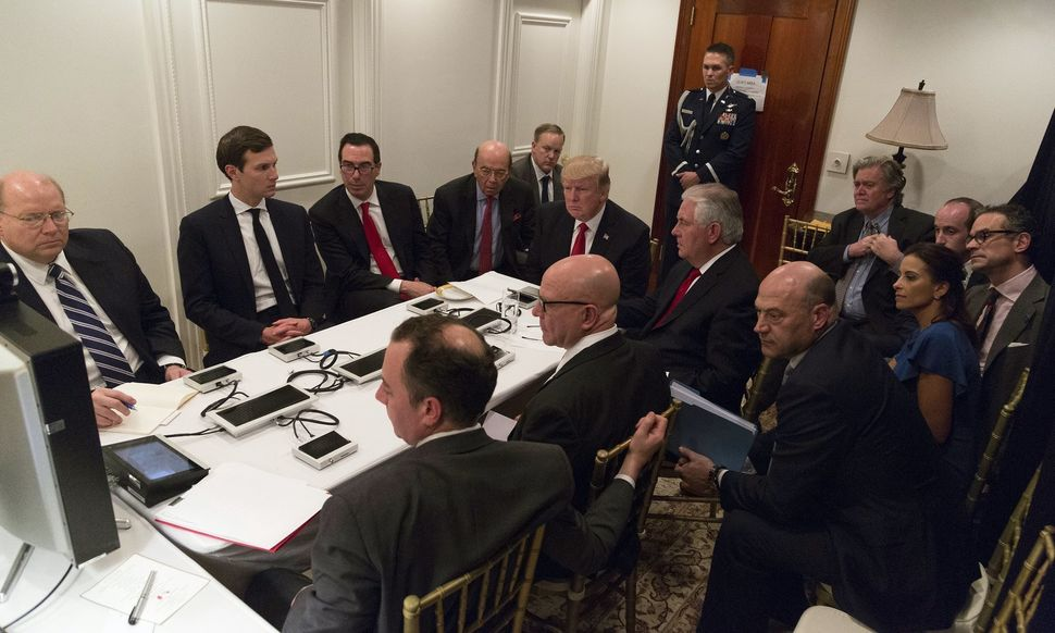 Trump receives a briefing on the Syria military strike from his national security team including a video teleconference with