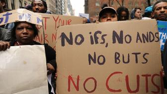 NEW YORK, NY - APRIL 20:  Activists attend a rally demanding that the Trump administration abandon proposals to cut the Housing and Urban Development's (HUD) budget on April 20, 2017 in New York City. Members of the #NoCuts Coalition, including an alliance of dozens of grassroots groups, civic organizations, faith leaders, and labor unions gathered at Federal Plaza to protest the proposed cuts. Around a dozen protesters briefly blocked traffic in an act of civil disobedience before being arrested.  (Photo by Spencer Platt/Getty Images)
