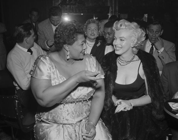 Actress Marilyn Monroe attends a jazz session at the Tiffany Club in Hollywood on Nov. 19, 1954. Ella Fitzgerald chats w