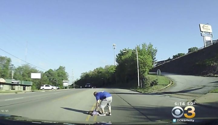 A volunteer firefighter is seen coming to the rescue of a 4-year-old girl after she fell from a bus.