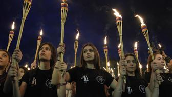 TOPSHOT - People take part in the torchlight procession as they mark the anniversary of the killing of 1.5 million Armenians by Ottoman forces in Yerevan on April 23, 2017.  Armenians commemorate on April 24, the 102 anniversary of the killing of 1.5 million by Ottoman forces, as a fierce dispute still rages with Turkey over Ankara's refusal to recognise the mass murder as genocide.  / AFP PHOTO / KAREN MINASYAN        (Photo credit should read KAREN MINASYAN/AFP/Getty Images)