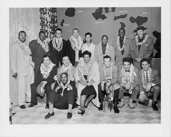"Group portrait of producer Norman Granz and the musicians of the ""Jazz at the Philharmonic,"" with Ella Fitzgerald, Ray Brown,"