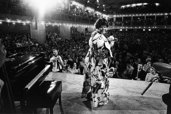 An undated photo of Ella Fitzgerald singing in Lucerna Hall.