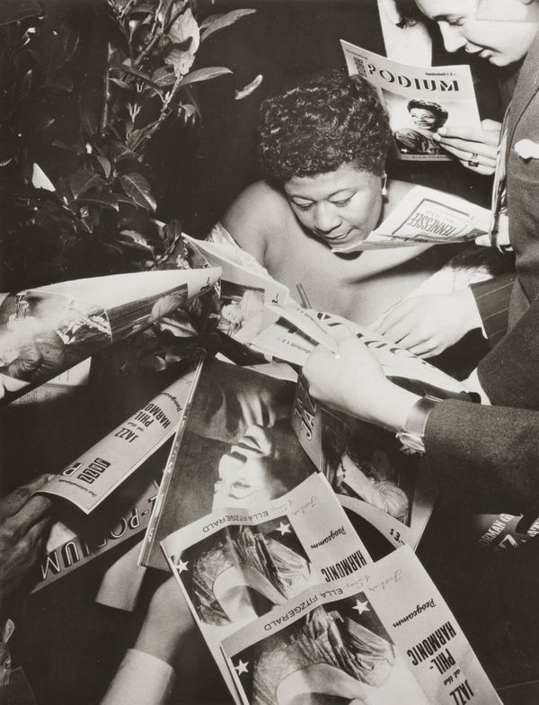 Ella Fitzgerald signing autographs at the concert series Jazz at the Philharmonic in Vienna in February 1954.