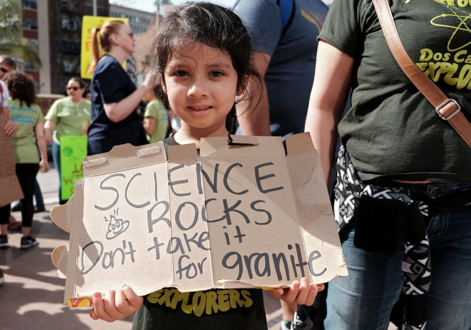 A young girl marches with scientists and supporters in a March for Science on April 22, 2017 in Los Angeles, California. (Pho