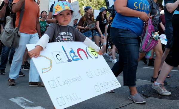 A young girl marches with scientists and supporters through downtown Los Angeles in a March for Science on April 22, 2017 in