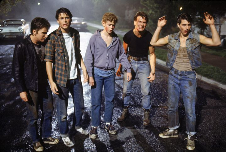 """American actors Emilio Estevez, Rob Lowe, Thomas C. Howell, Patrick Swayze, and Tom Cruise on the set of """"The Outsiders,"""" dir"""