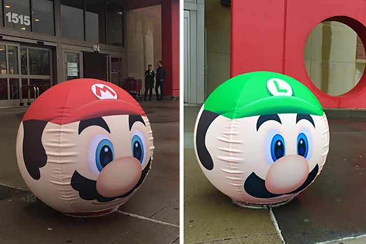 The bollards in front of the stores are now Mario themed too.