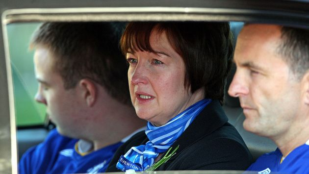 The real Melanie Jones, with her husband Stephen (right) and son Owen (left) leaving the funeral of her...