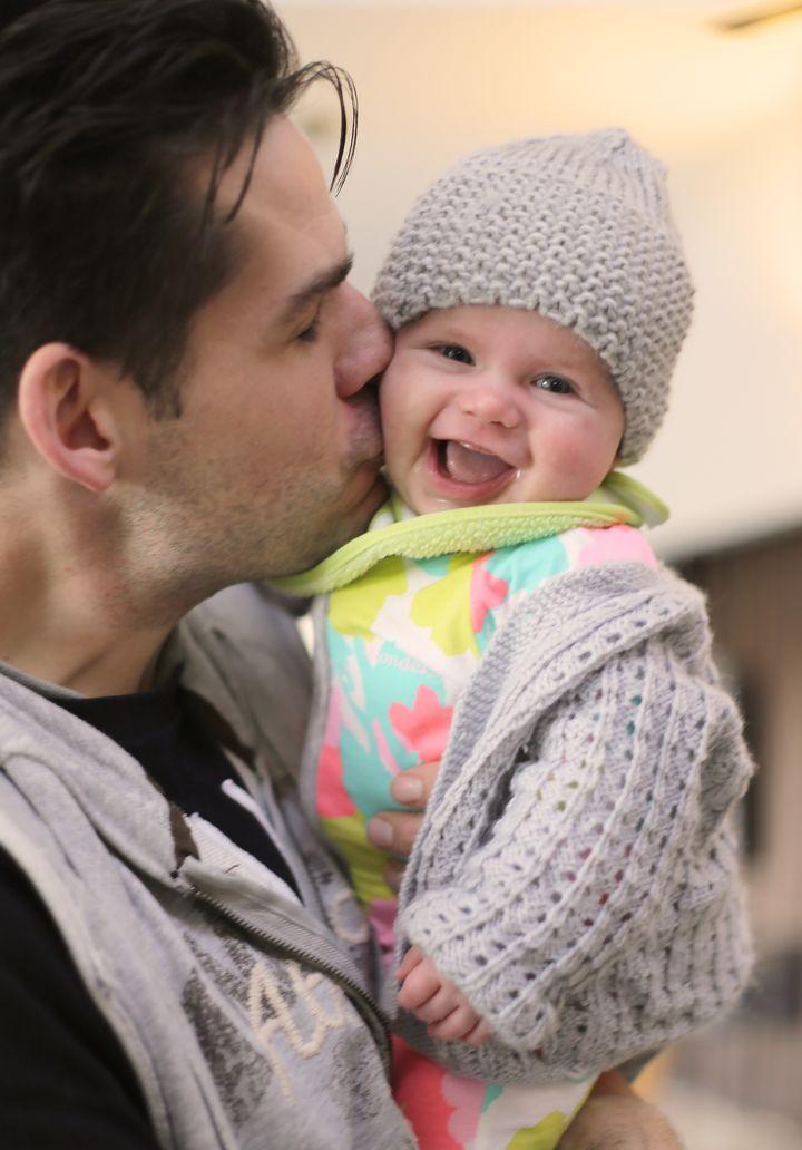 Nathan kissing Olive