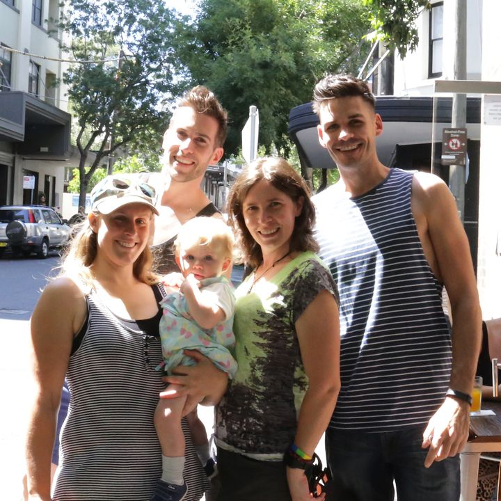 Bianca (left) holds Olive with Alison, Michael (back left) and Nathan