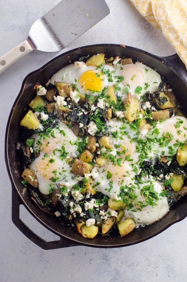 "<strong>Get the <a href=""https://umamigirl.com/baked-eggs-potatoes-kale-skillet/"" target=""_blank"">Baked Eggs with Potatoes an"