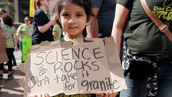 LOS ANGELES, CA - APRIL 22:  A young girl marches with scientists and supporters in a March for Science on April 22, 2017 in Los Angeles, California. The event is being described as a call to support and safeguard the scientific community. (Photo by Sarah Morris/Getty Images)